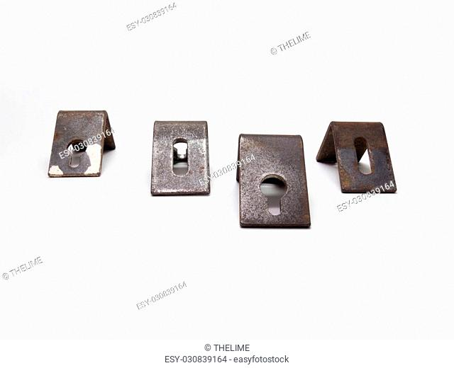 Four metal corners for hanging cabinets, with round and oval holes for mounting