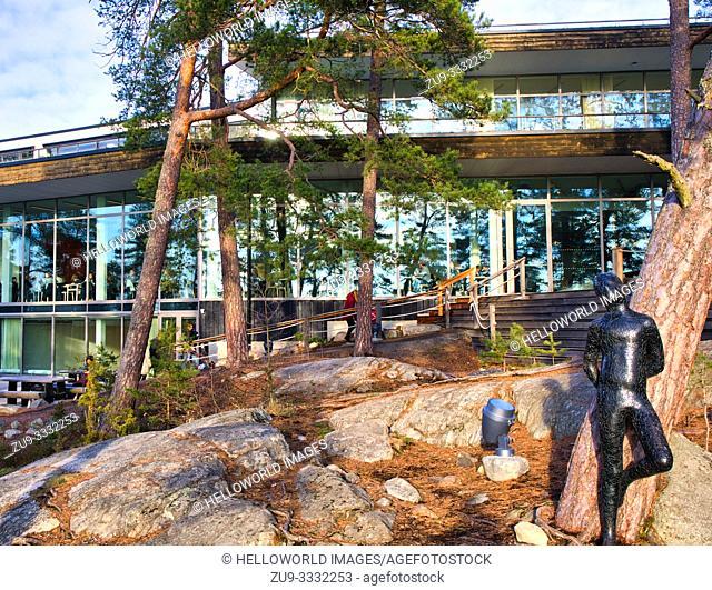 Sculpted figure leaning against tree, Artipelag, Halludden Peninsula, Varmdo, Sweden, Scandinavia. Artipelag is an international venue for art