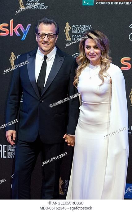 Italian director Gabriele Muccino with his wife Angelica Russo attends the red carpet of 62° David di Donatello Award at De Paolis Studios