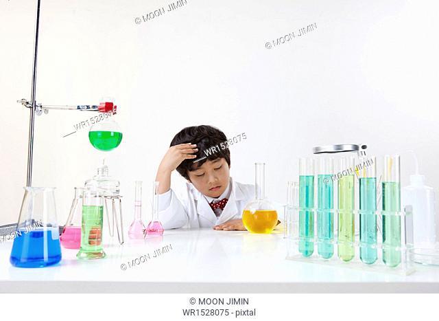 a boy doing chemistry