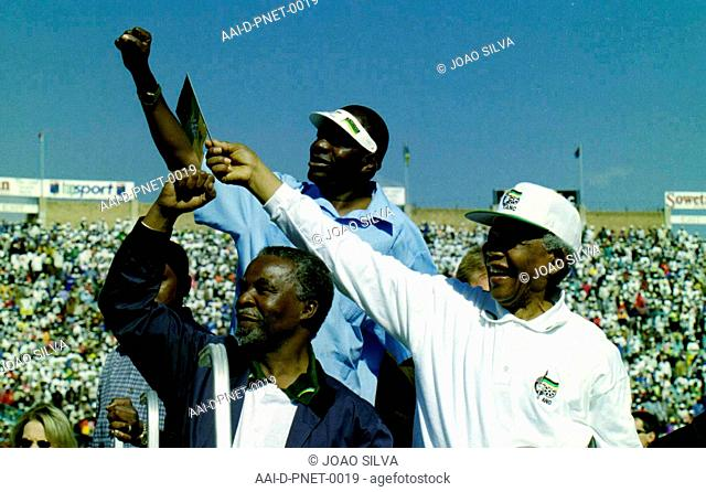 South Africa: Soweto: May 30, 1999: African President Nelson Mandela (right) and Deputy President Thabo Mbeki greet crowds from the top of a golf cart at an ANC...