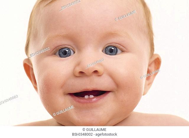 PORTRAIT OF AN INFANT LAUGHING<BR>Model.<BR>7 month old newborn