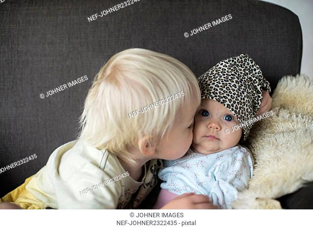 Brother with baby sister