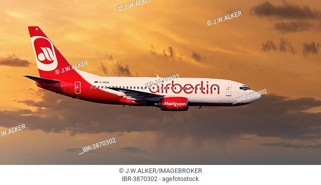 Air Berlin Boeing 737-73S in flight during a thunderstorm in the evening light