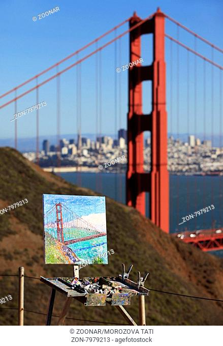 Famous Golden Gate Bridge and his image drawn on a canvas, San Francisco at day, USA
