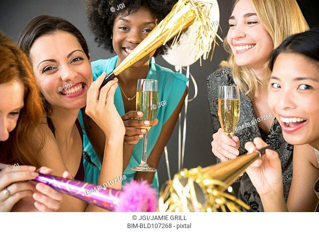 Smiling women celebrating at party
