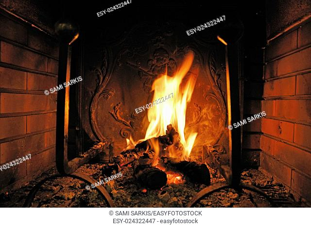 Log fire burning in a fireplace