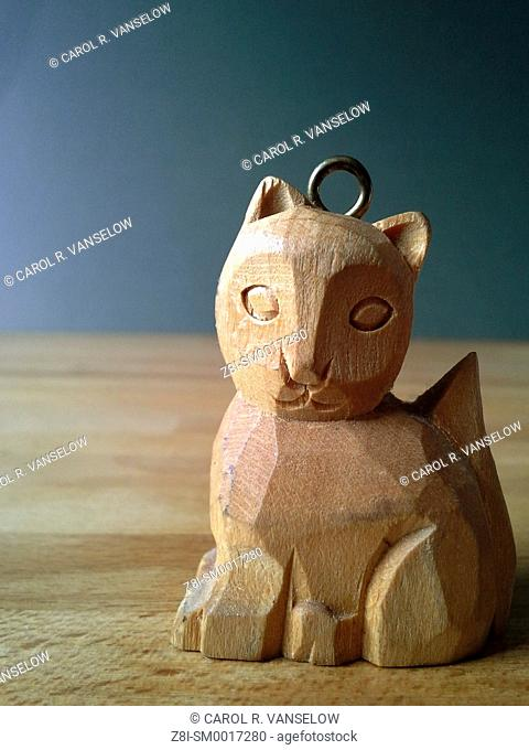 Small wooden cat. When dabbed with essential oils it can be used as an air freshener