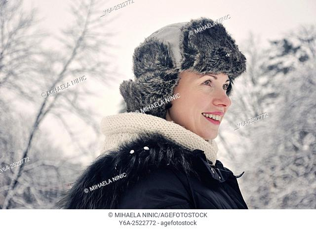 Portrait of a smiling mid adult woman, winter