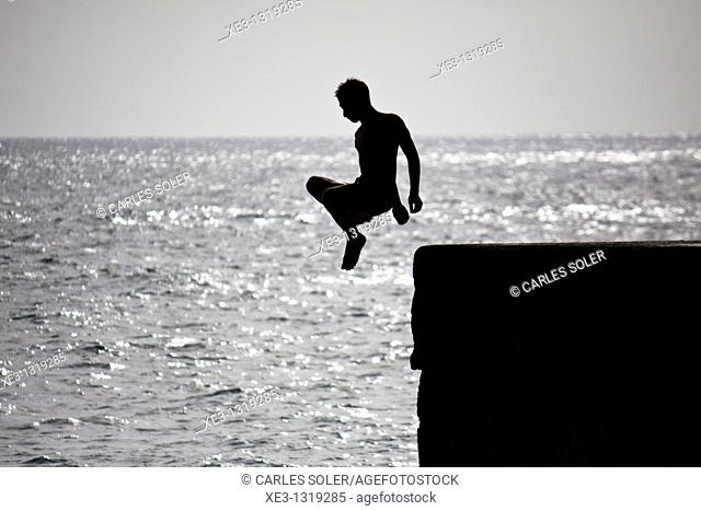 Young swimmer jumping