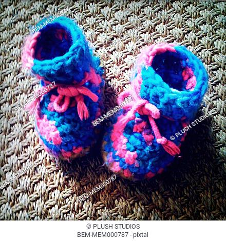 Close up of knitted baby booties