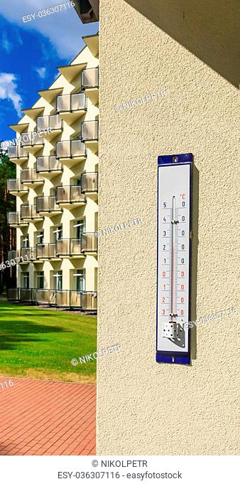"""Street thermometer at the entrance to the wellness resort """"""""Egle. Druskininkai, Lithuania"""