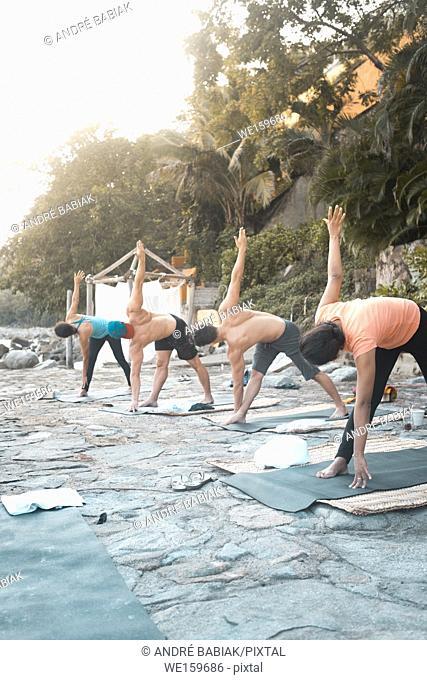 Group of multiple people exercising outdoors. Yoga retreat Puerto Vallarta - Mismaloya, Mexico