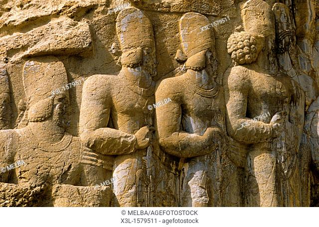 Relief in historic tomb of King Darius, Dareios II , Achaehenid burial site Naqsh-e Rostam, Rustam near Persepolis  Iran