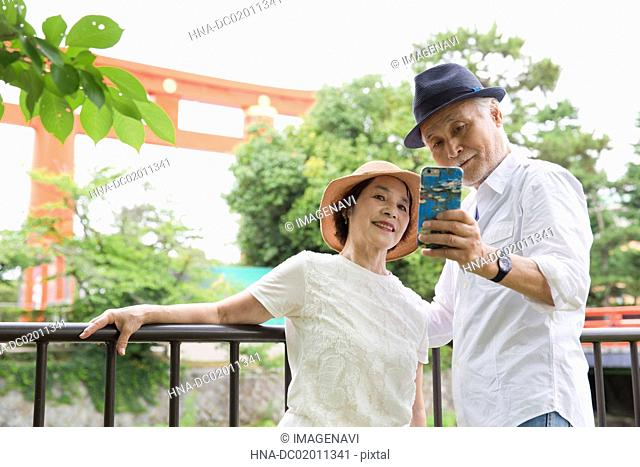 Senior couple taking selfie with smart phone