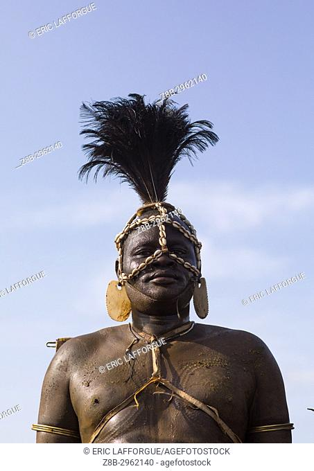 Portrait of a Bodi tribe fat man during Kael ceremony, Omo valley, Hana Mursi, Ethiopia
