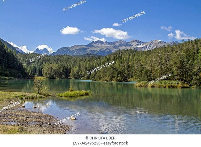 The Weißensee is a mountain lake in the border area of the Lechtal Alps and Mieminger Mountains north below the Fern Pass in Tyrol