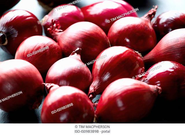 Fresh whole red onions on table