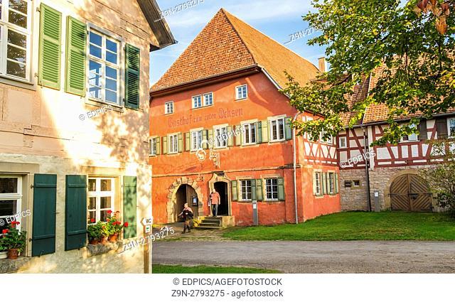visitors in front of the red ox inn serving the open air museum, wackershofen, schwäbisch hall, baden-wuerttemberg, germany