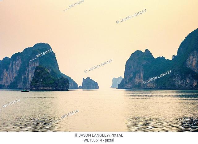 Karst mountain landscape in Ha Long Bay afer sunset, Quảng Ninh Province, Vietnam