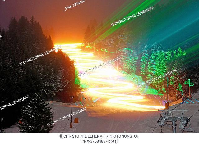 Vosges. Gerardmer in winter. ski slope during the torchlight parade of skiers ski school. Laser show