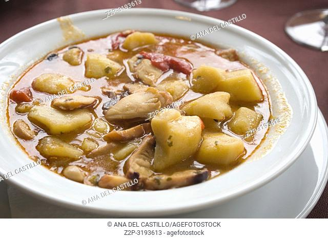 Seafood stew with cutle fish and potatoes Spain