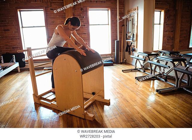 Woman practicing pilates in fitness studio