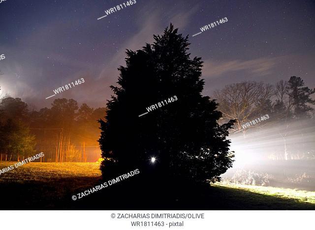 Eery nighttime landscape in countryside