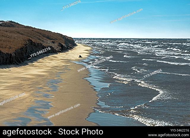 Sand dunes, beach and multiple waves at Ludington State Park near Ludington, Michigan, USA. . Ludington State Park is a state park located just north of...