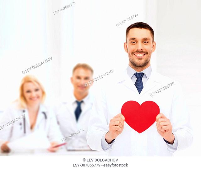 medicine, profession, and healthcare concept - smiling male doctor with red heart