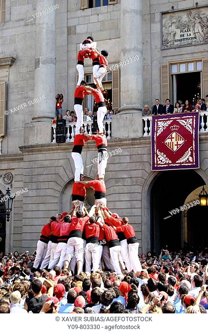 'Castellers' human towers builders in Plaça de Sant Jaume, La Merce festival, Barcelona. Catalonia, Spain