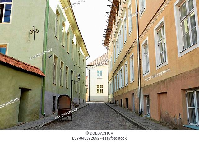 travel, tourism and european architecture concept - old town street with abandoned gig in tallinn city in estonia