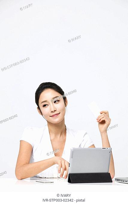 Businesswoman Holding A Credit Card, Using Laptop