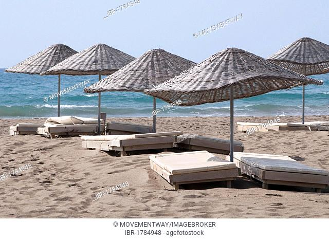 Sunbeds and sunshades on Iztuzu beach, Dalyan, Lycia, Turkey, Asia