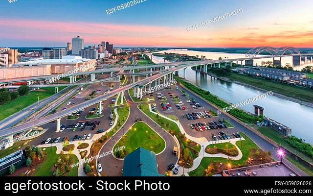 Memphis, Tennessee, USA aerial skyline view with downtown and Mud Island at dusk