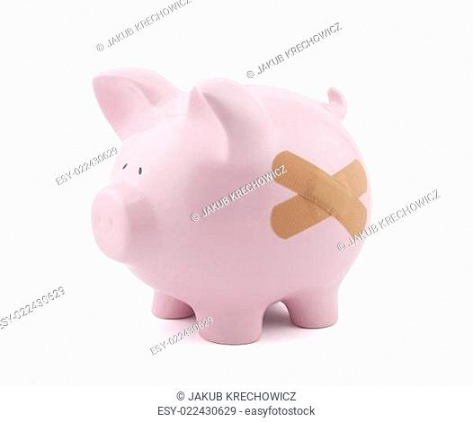 Piggy bank with plaster. Clipping path included