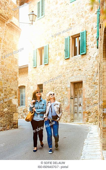 Two mature female friends strolling, Tuscany, Italy