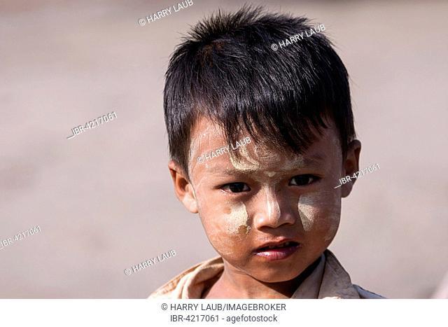 Local boy with Thanaka paste on his face, portrait, Fishing Village Ngapali, Thandwe, Rakhine State, Myanmar