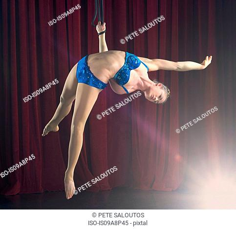 Female aerialist performing on rope