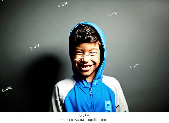 Boy wearing hooded top