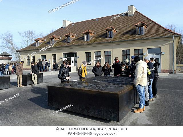 Visitors stand on the grounds of the former concentration camp Sachsenhausen in Oranienburg, Germany, 18 February 2014. According to the Foundation Brandenburg...