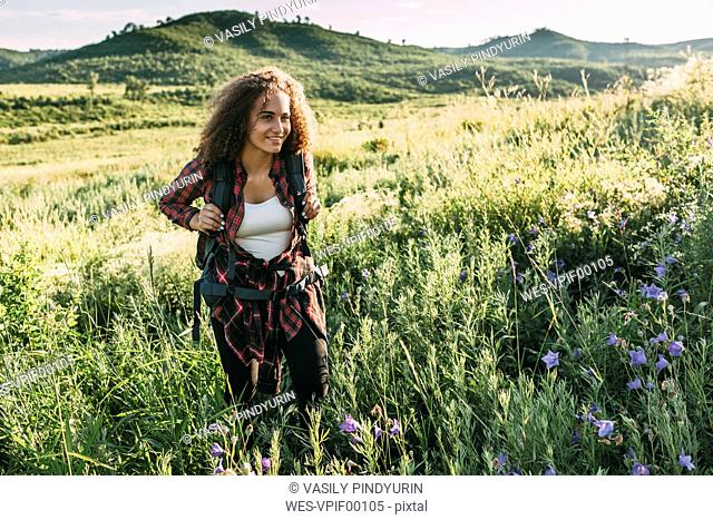 Teenage girl with backpack in nature