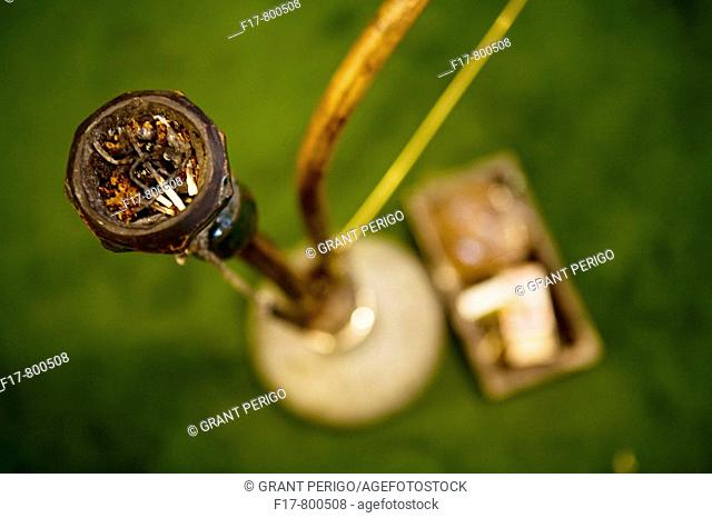 beautiful shot of a pipe ahot from above on a green carpet