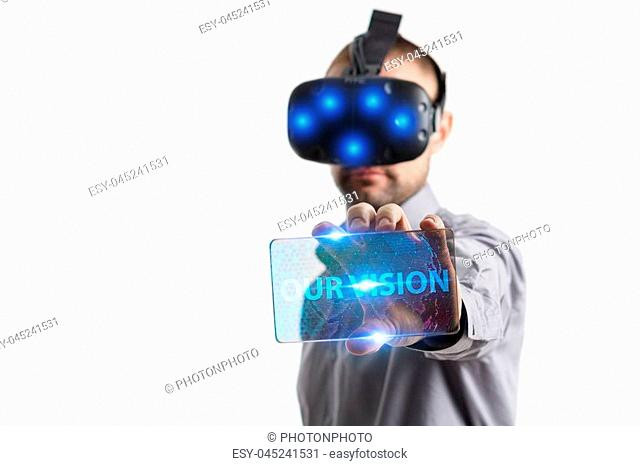Business, Technology, Internet and network concept. Young businessman working in virtual reality glasses sees the inscription: Our vision
