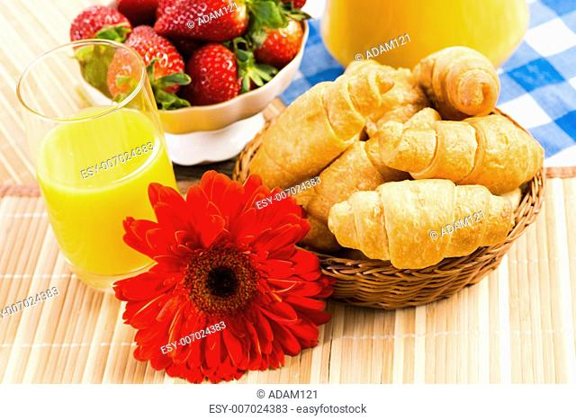 early breakfast, juice, croissants and Berries, still life