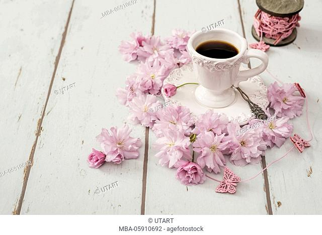 Cup, coffee, silver spoon, wooden board, Japanese cherry blossoms, reel of thread, thread, pink, to butterflies
