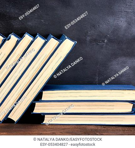 books in the blue cover, black background, copy space