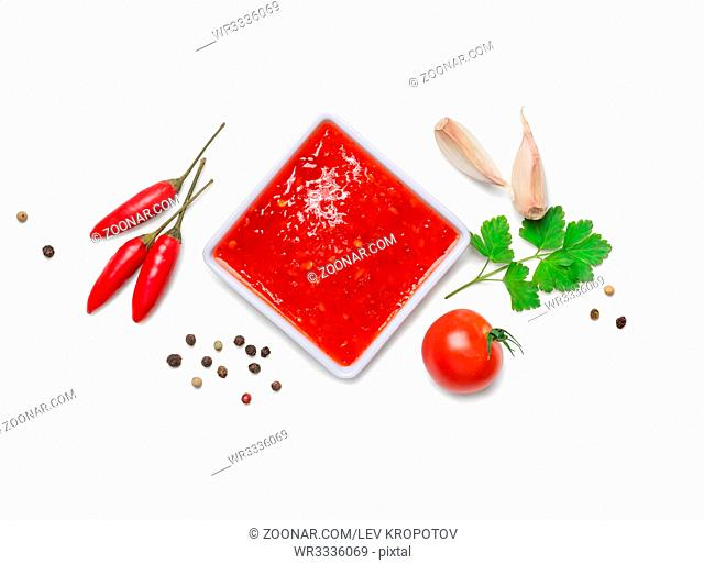 red hot chilli sauce isolated on a white background.Top view