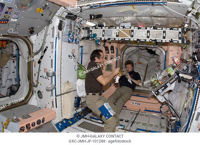 Russian cosmonaut Gennady Padalka (right), Expedition 32 commander; and NASA astronaut Joe Acaba, flight engineer, eat a snack near the galley in the Unity node...