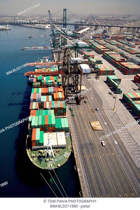 Cranes over container ship at commercial dock, Port of Los Angeles, California, United States